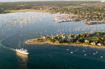 Aerial view of Nantucket Harbor with Steamship Authority ferry rounding Brant Point