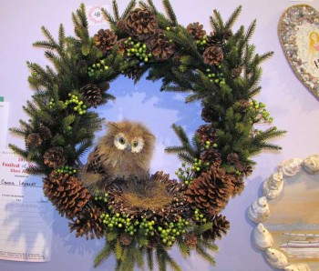Owl with a nest in the center of a wreath