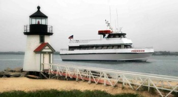 Freedom Cruise Ship passing behind the lighthouse