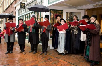 Carolers dress in Vicotian clothing